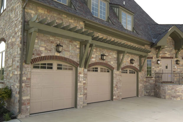 Haas Door - Model 2060 Garage Door in Sandstone with 6-Pane Arch Windows